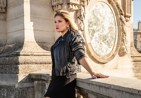 woman-in-black-skirt-and-black-jacket-standing
